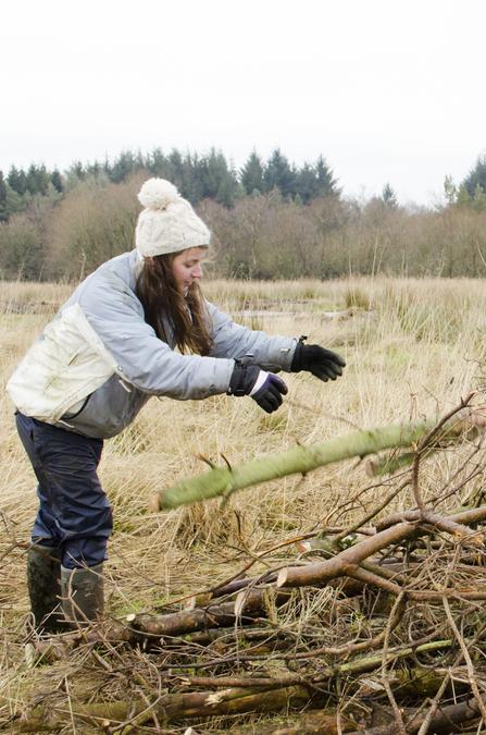 Woman building hibernaculum
