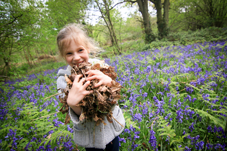 Child with leaves & bluebells (c) Tom Marshall