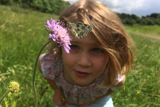 Child with marbled white butterfly - Adam Cormack