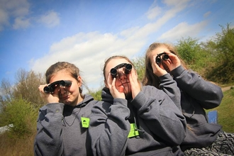 Young people looking through binoculars