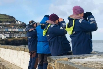 Living Seas Wales volunteers conducting a land survey in New Quay, South Wales