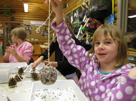Florrie making a bird seed cake at Wildlife Watch
